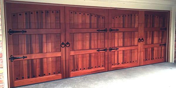 Picture of wood garage door on home.