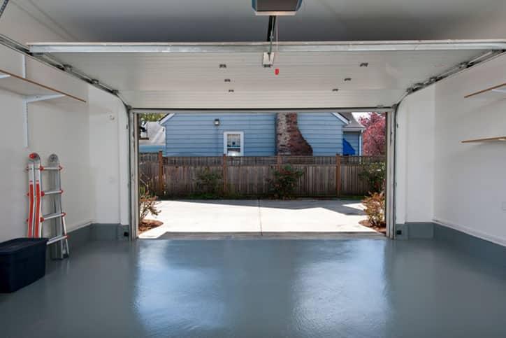 Picture of clean garage with door open.