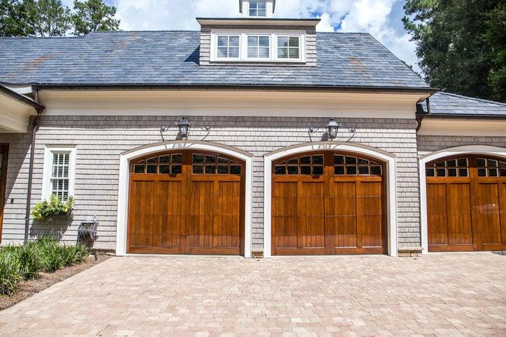 Wooden garage doors on home.