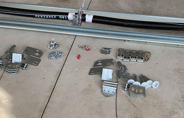 Garage Door Parts in Ann Arbor MI on Concrete Floor