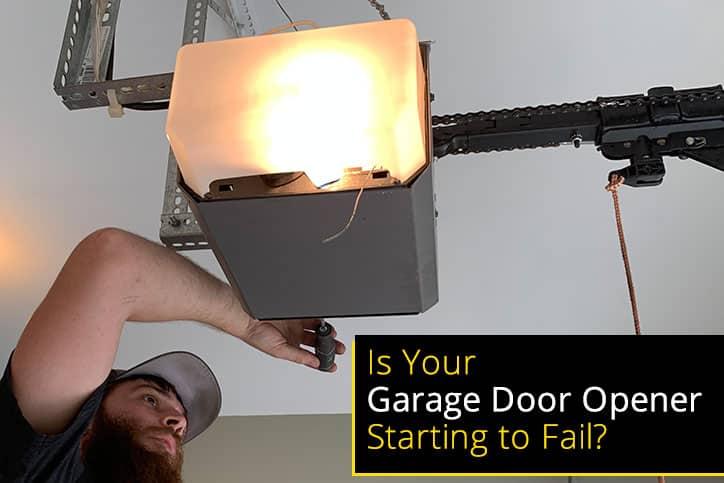 Technician Checking Garage Door Opener Failing