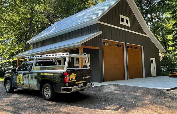 Garage Door Company Truck in Front of New Garage Doors in Lowell MI
